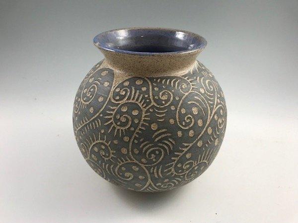 round sgraffito vase